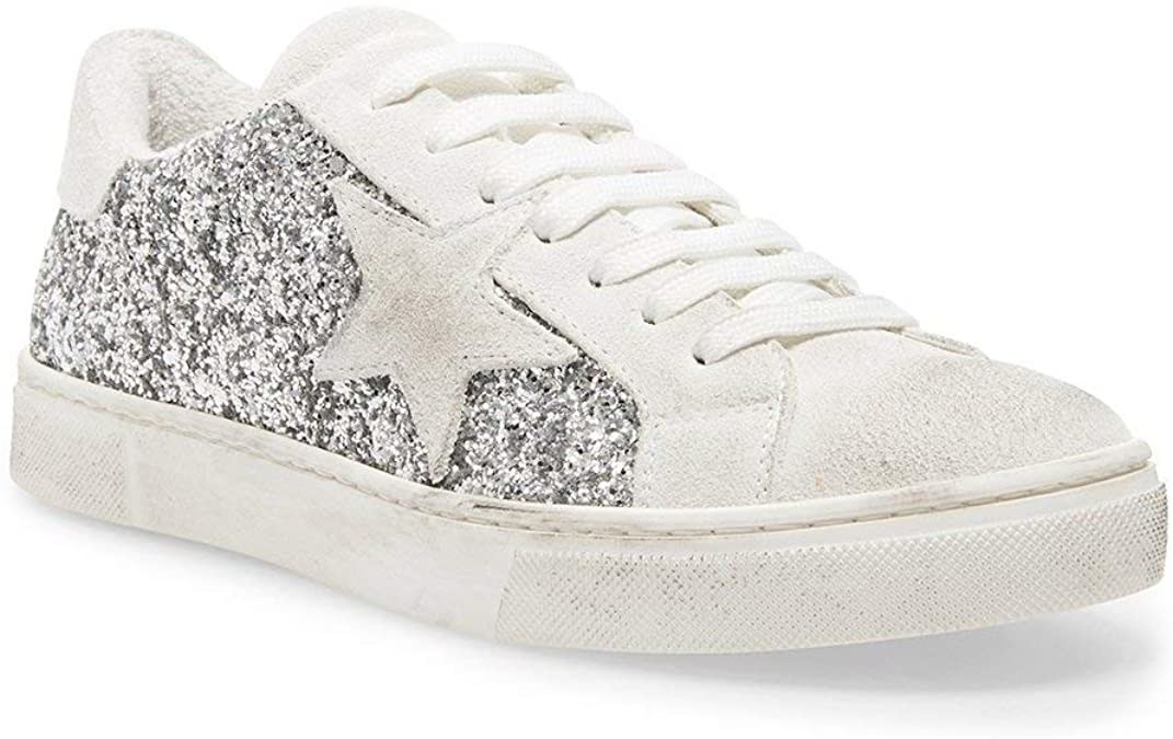 One sneaker with a sparkly side panel and a star