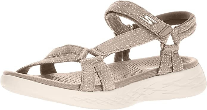 A sport sandal with a faintly sparkly upper and a rubber bottom