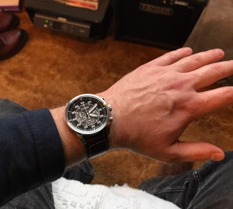 reviewer wears watch