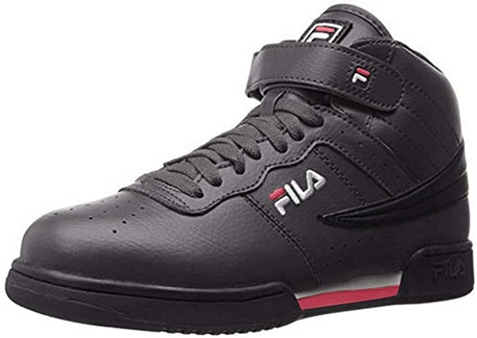 A hightop sneaker with lacing and a velcro strap across the ankle