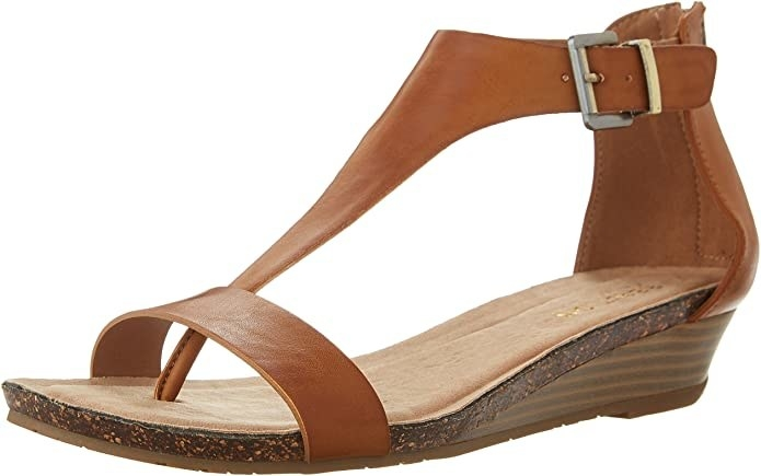 A thing sandal with a buckle closure around the ankle