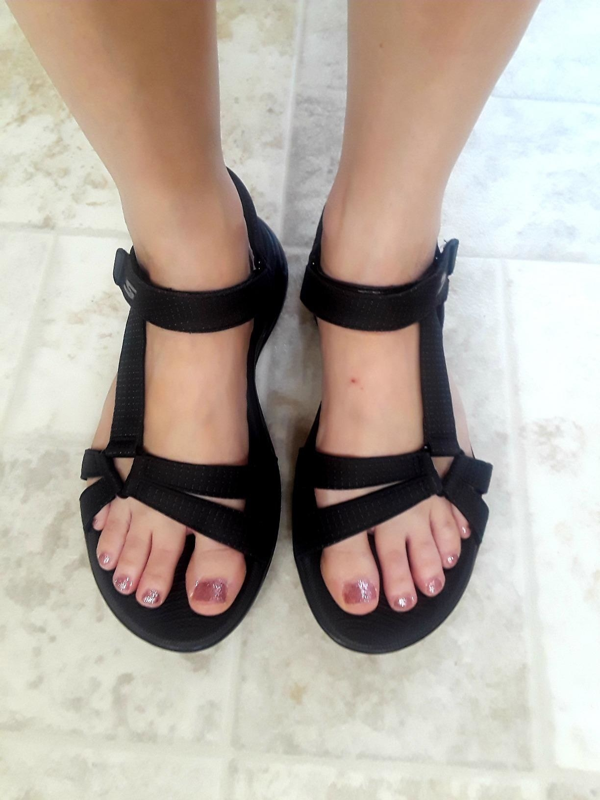 reviewer wears strappy black sandals