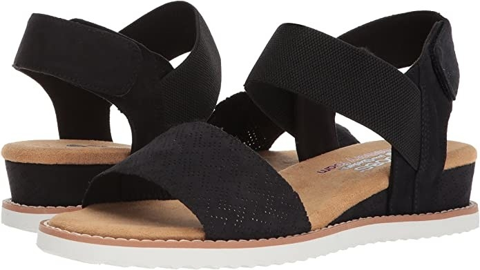 A pair of sandals with velcro at the back