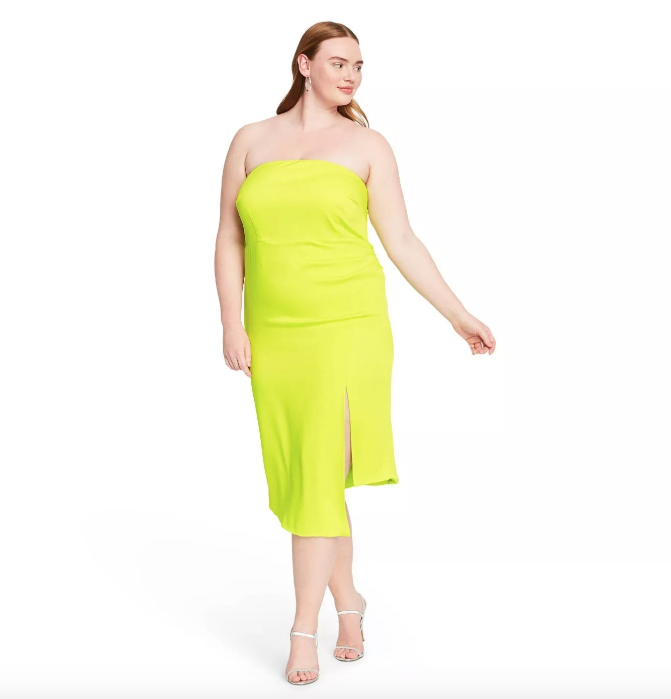 Model wearing the bright green strapless dress