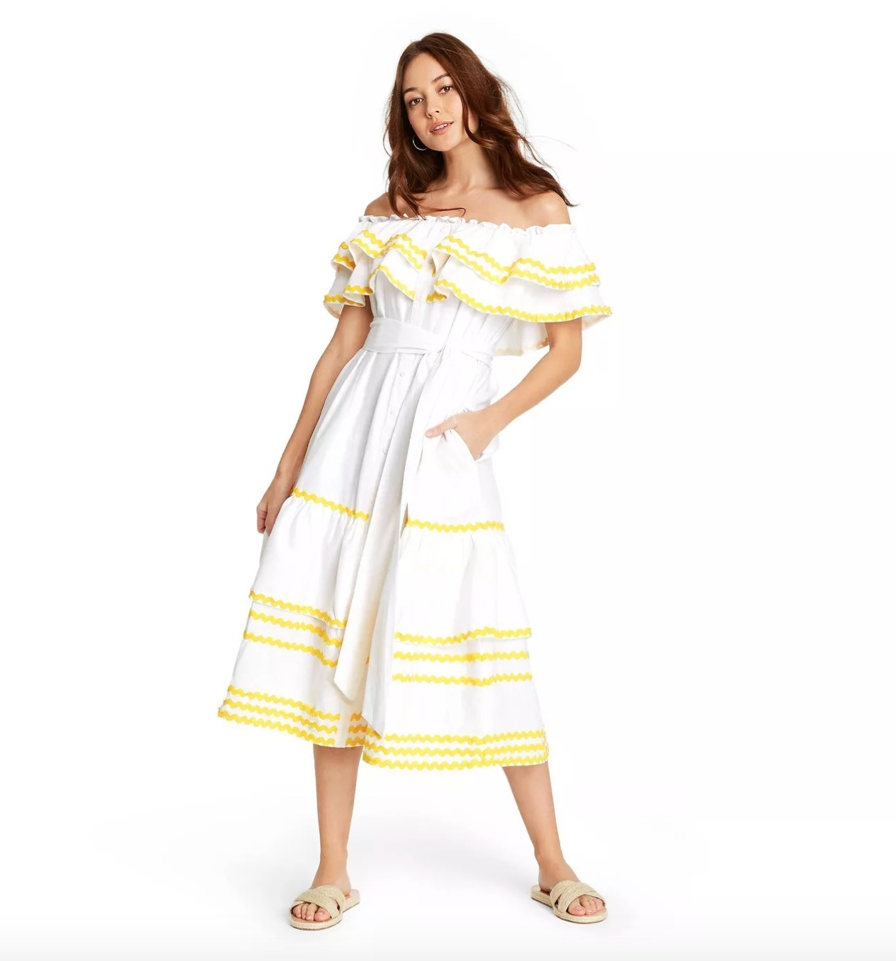 Model wearing the white dress with yellow trim