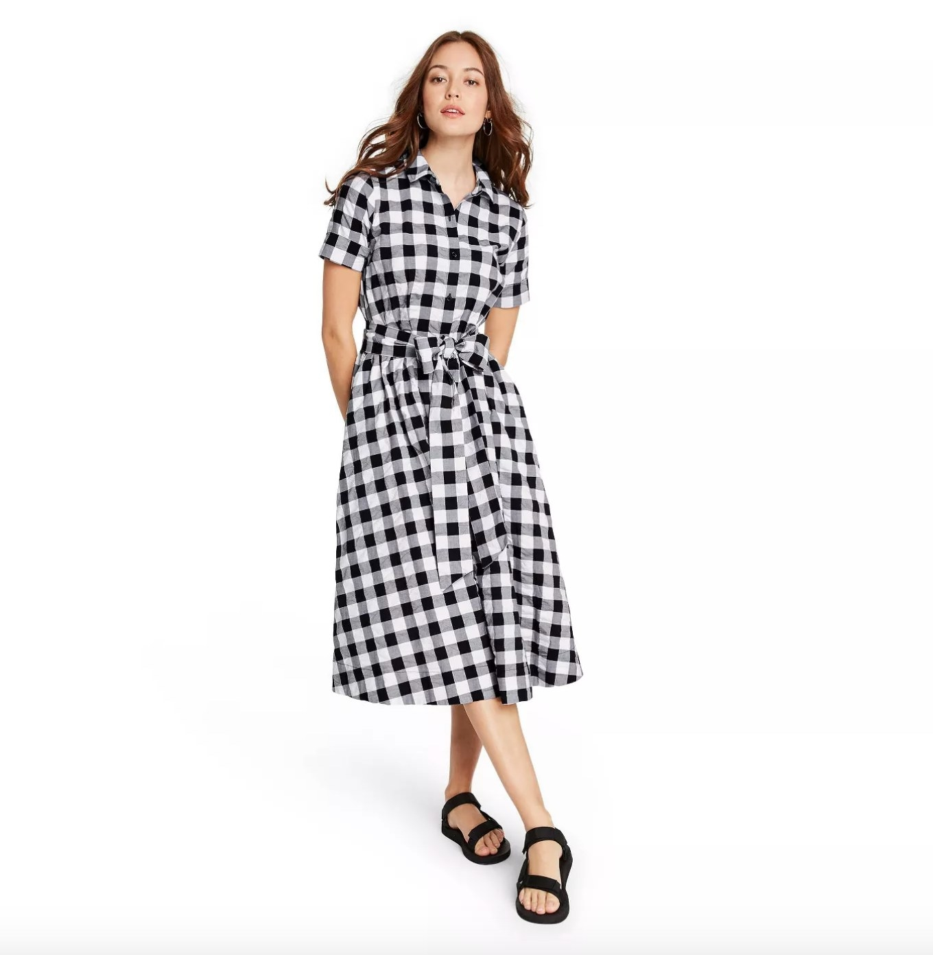 Model wearing the black and white gingham shirtdress