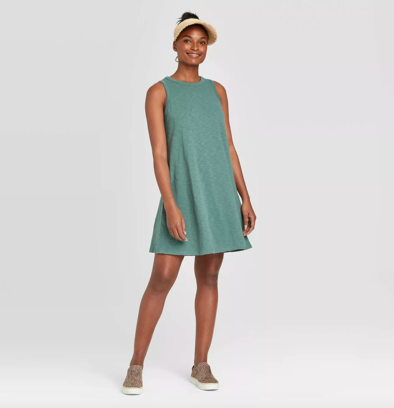 Model wearing the dress in teal