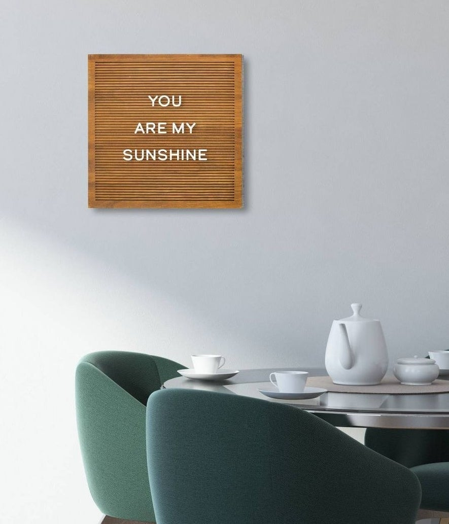 """brown board with white letters spelling """"you are my sunshine"""""""