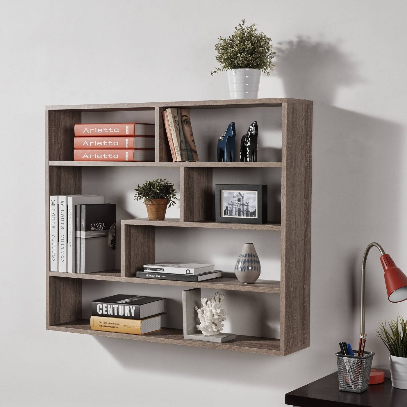the brown rectangular shelf with multiple storage slots