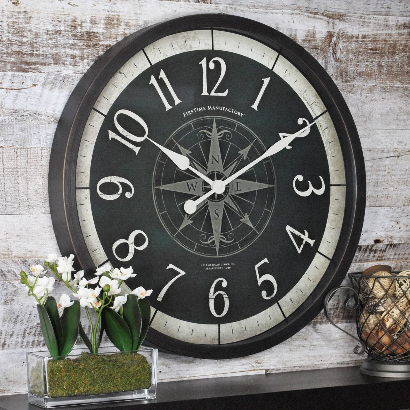the black clock with white numbers