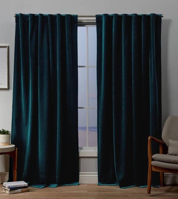 the teal velvet curtains