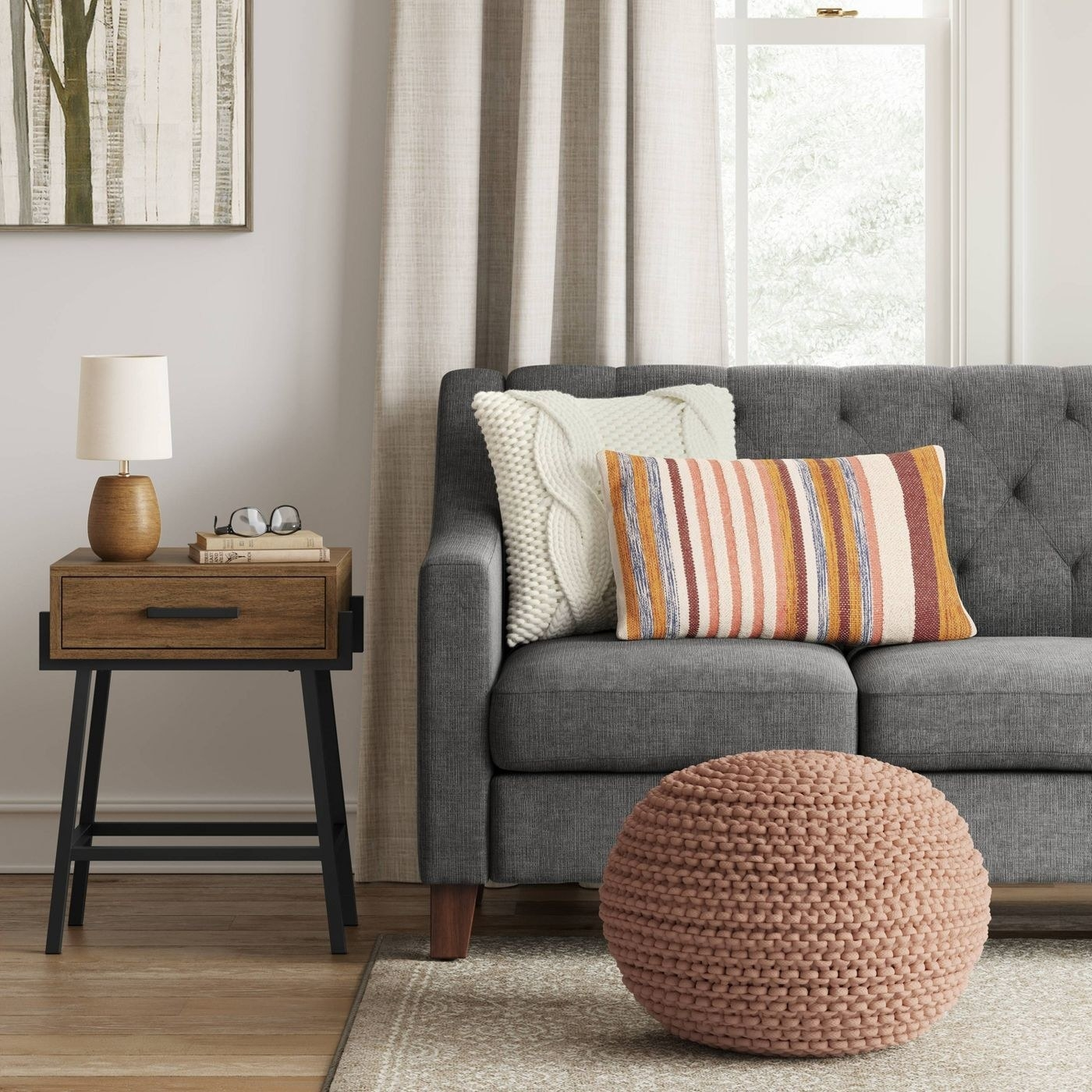 a blush and beige chunky knit pouf