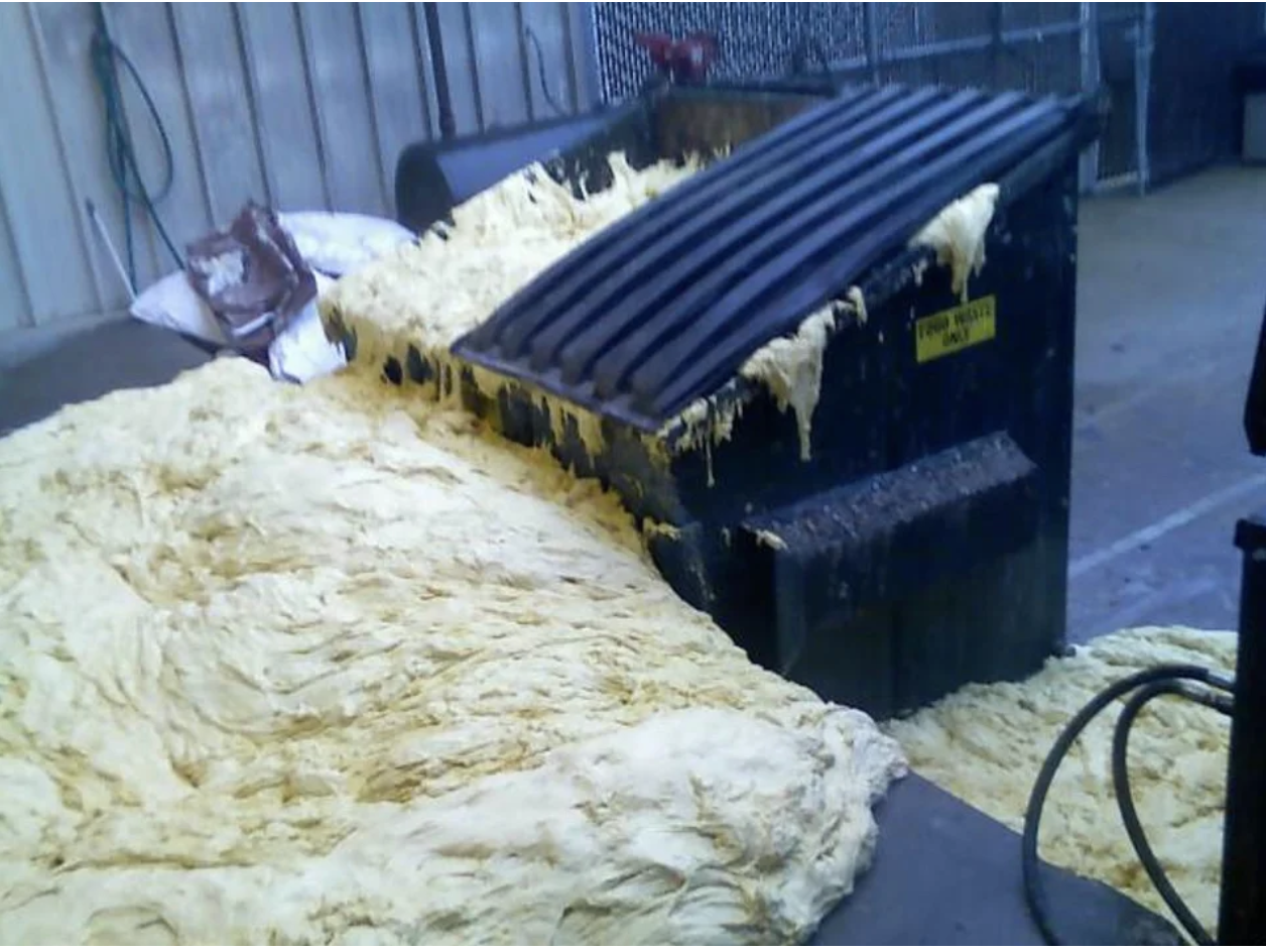 A dumpster overflowing with dough