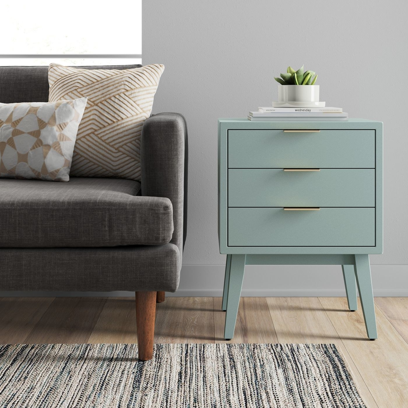 the light blue table with gold drawer handles