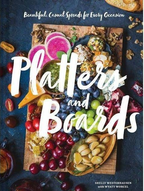 The cover of a book with a charcuterie board
