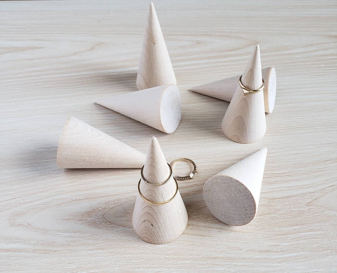 light wood cones with rings on them