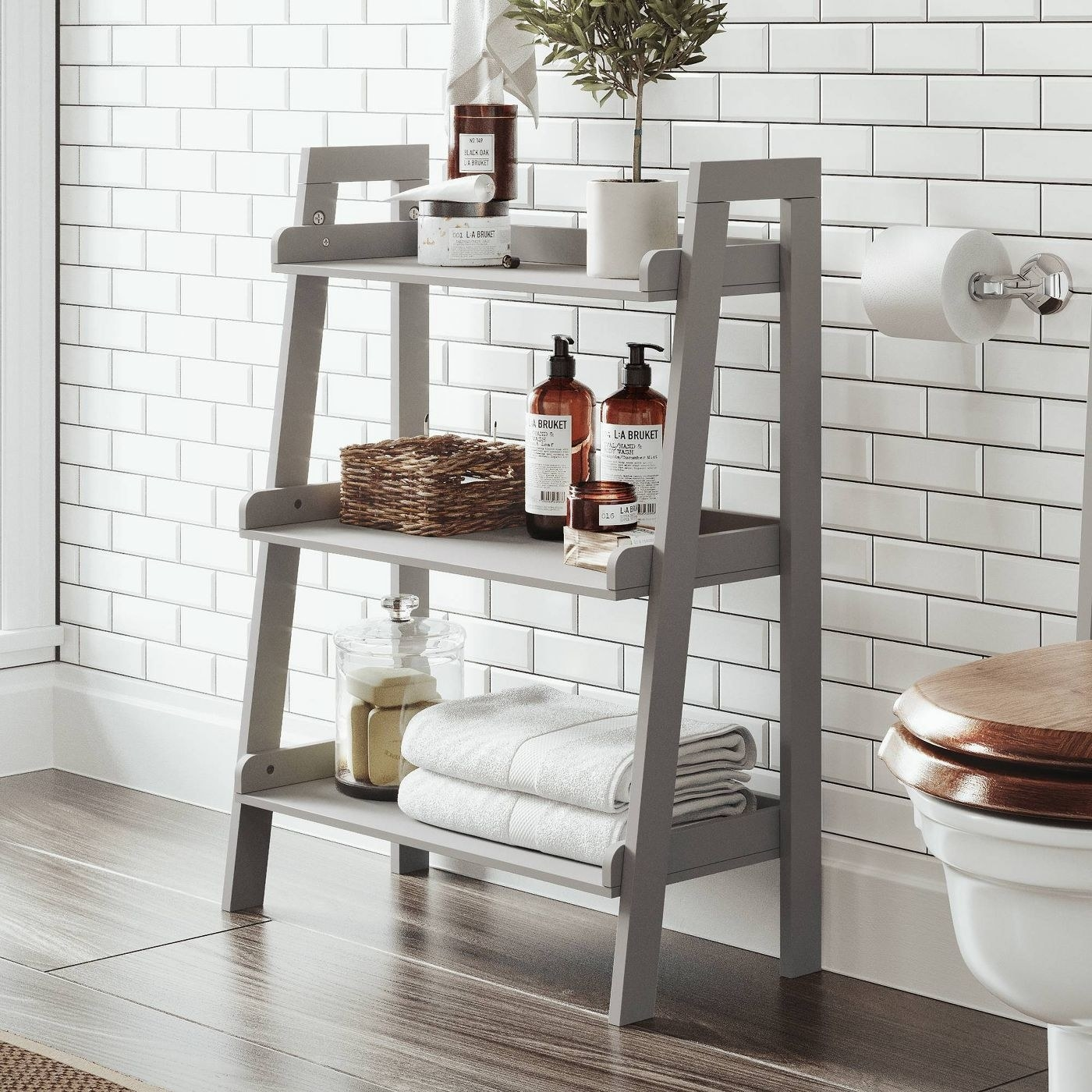 the gray ladder with three steps