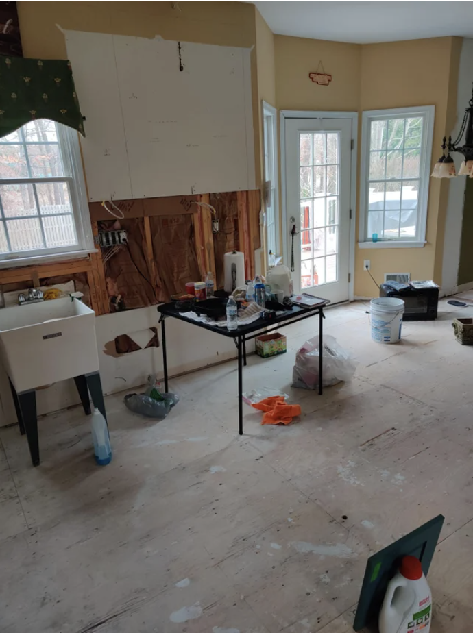 A kitchen that has been torn apart for renovation