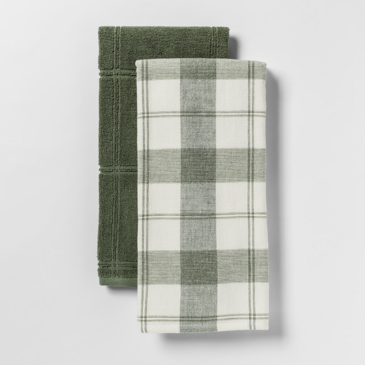 Two kitchen towels, one in solid dark green and the other in light plaid green