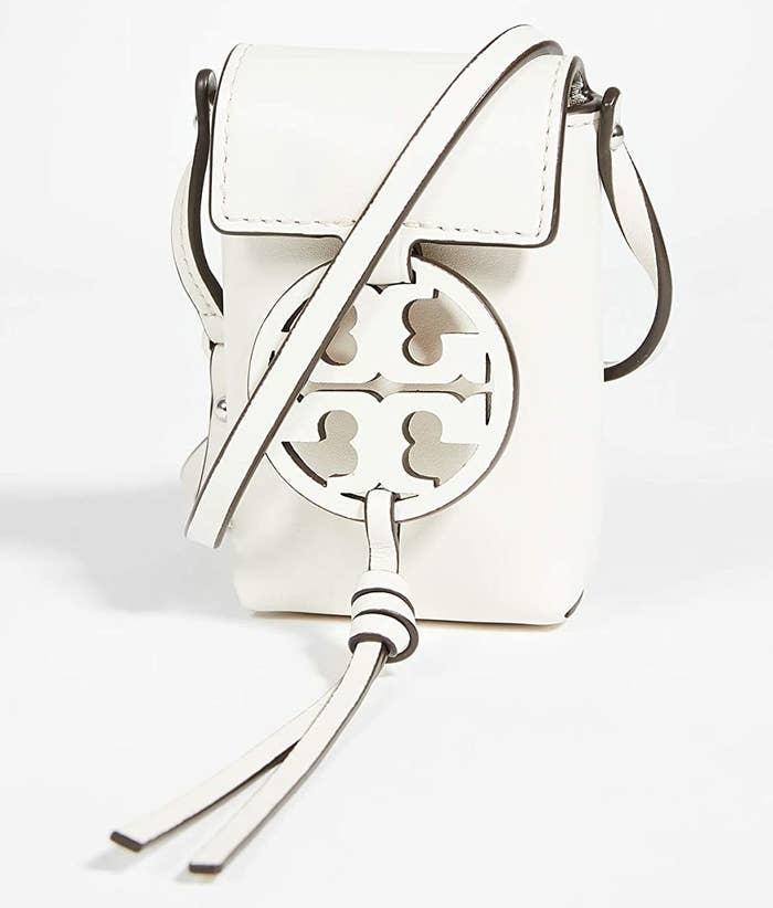 The narrow, white leather crossbody