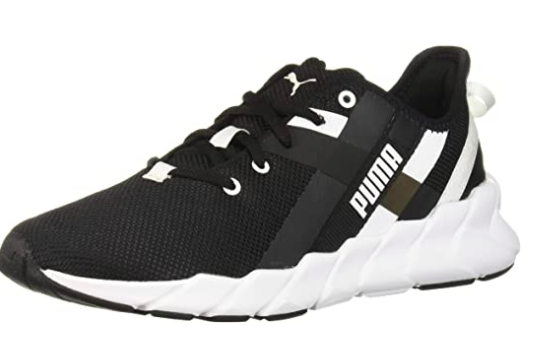 A Puma black and white Weave Xt Sneaker with criss-cross detailing