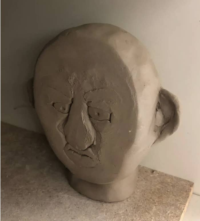 A sculpture of a head that has been smashed in