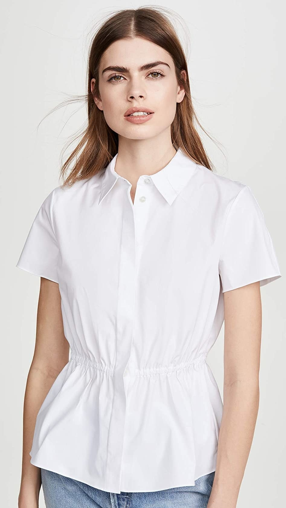 The plain white blouse with a cinched middle