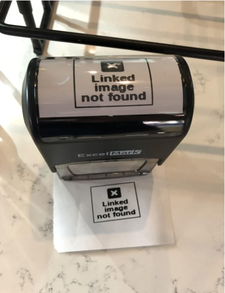 "A stamp that stamps ""Linked image not found"""
