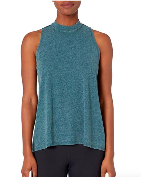 Model wears teal mock neck workout tank