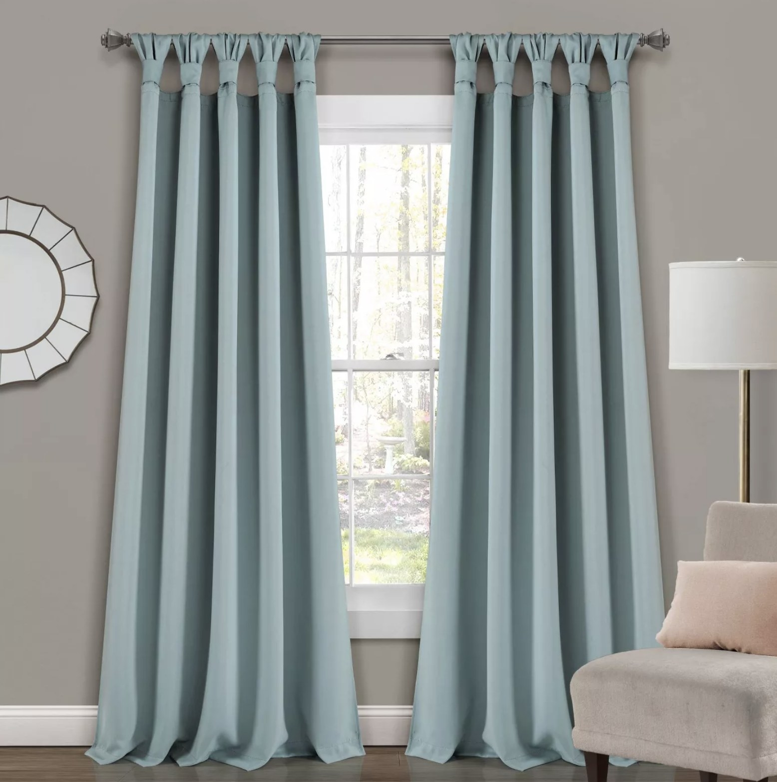 A set of light blue blackout curtains over a window