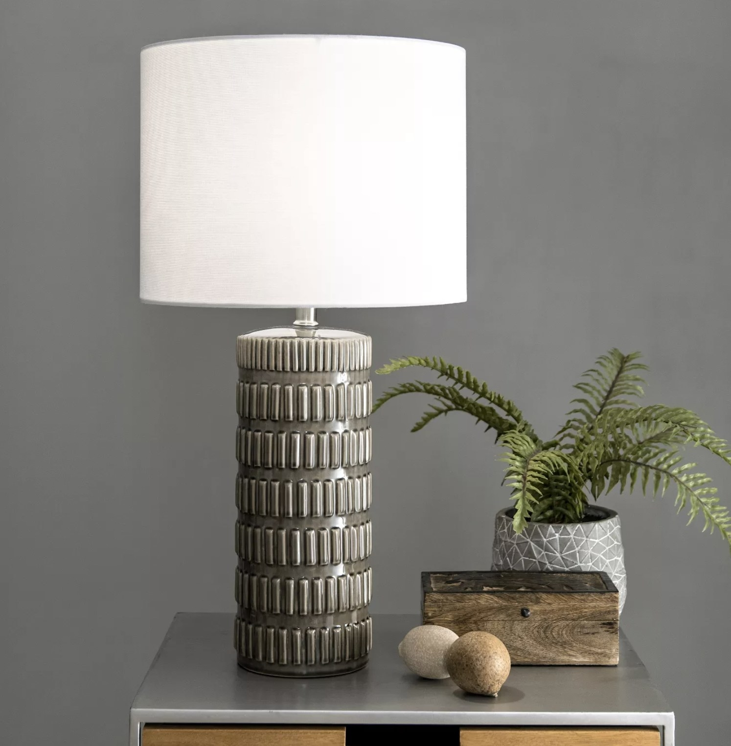 A gray lamp with rectangular pattern detailing