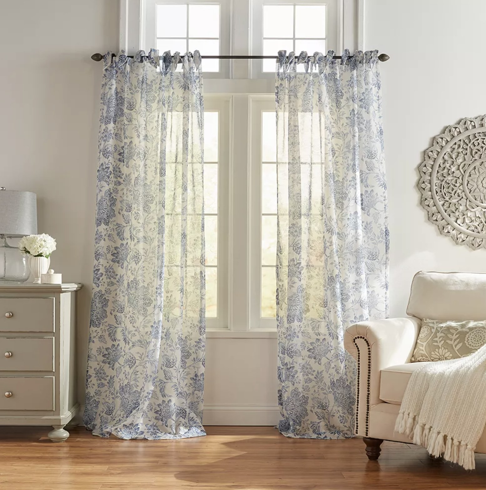 White see-through curtains with blue floral detailing