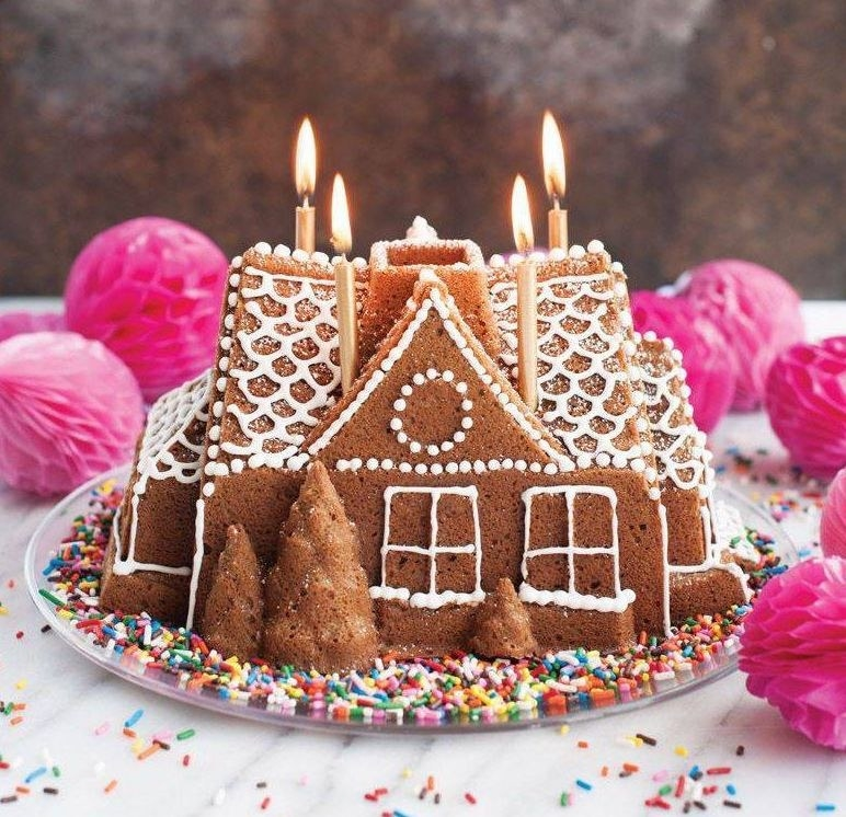 a gingerbread house with icing trim