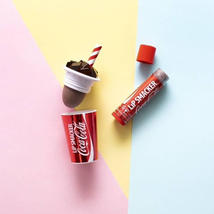 A tube of lip balm in the shape of a soda can