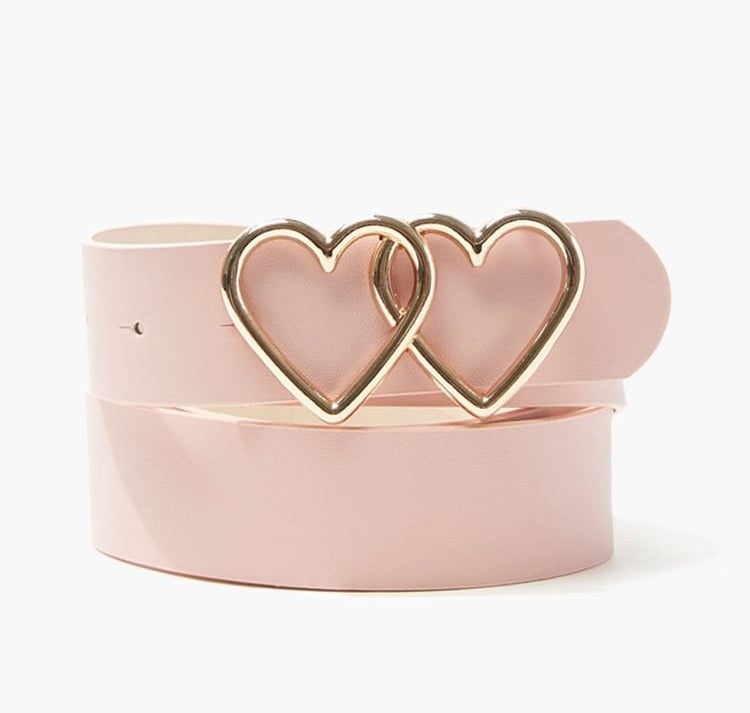 pink belt coiled with two brass hearts