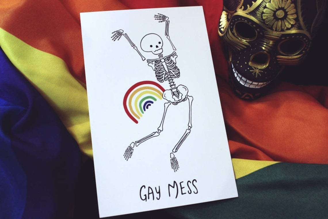 """A skeleton flailing its arms around, with a rainbow by its side and the words """"Gay Mess"""" beneath its feet"""