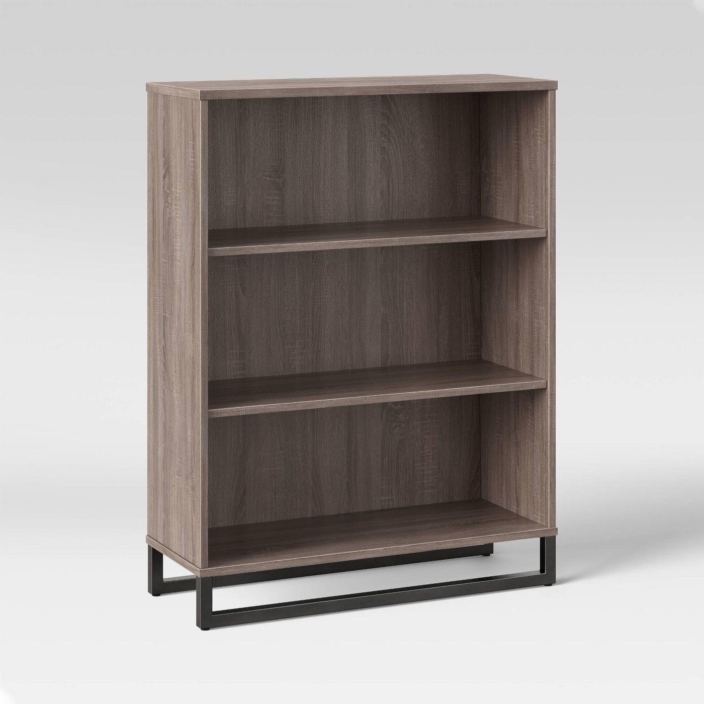 the gray bookshelf with black legs