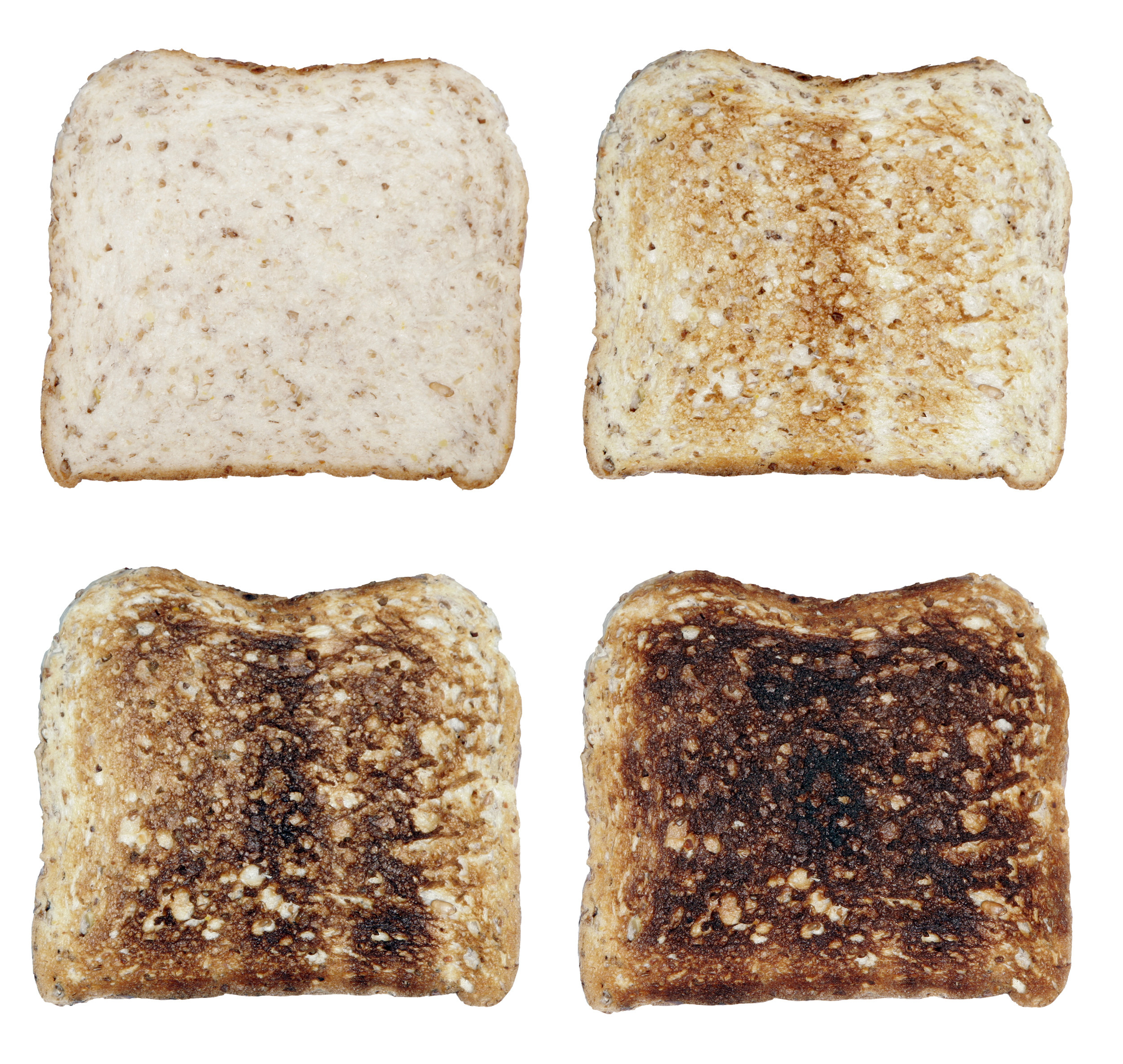 Four slices of toasted white bread in order or least toasted to burnt.