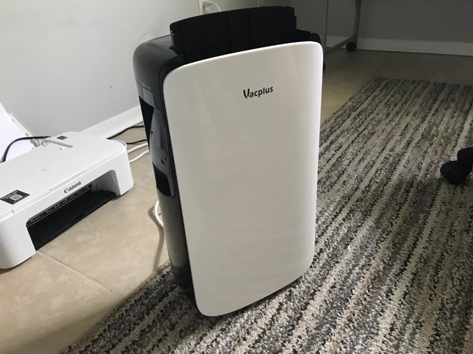 A black dehumidifier with a large white front panel