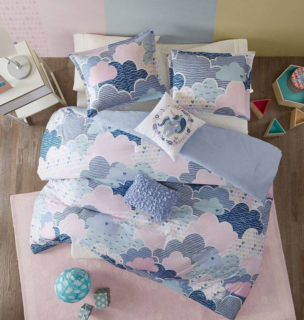 the comforter in blue and pink