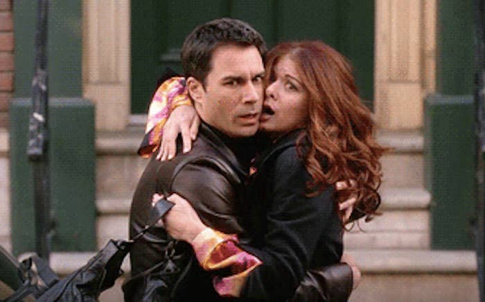 Will and Grace hug on the streets of NYC
