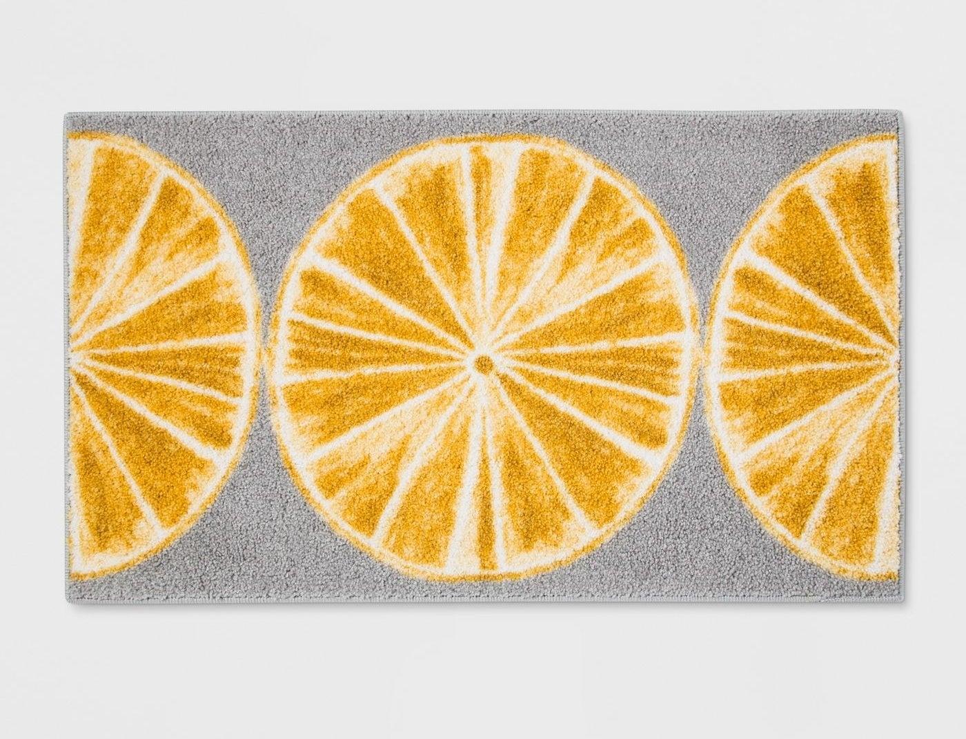 gray rug with yellow lemons