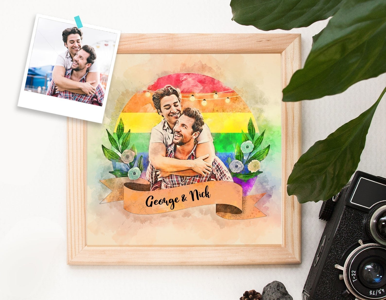 A wall art print of a couple with a rainbow background and an actual picture of the couple next to it, showing the personalized illustration
