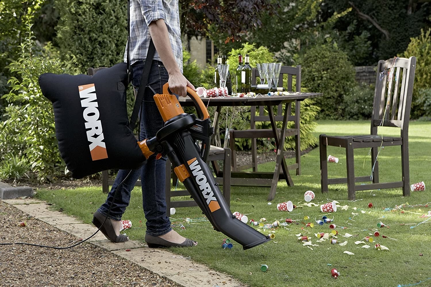 A model using the leaf blower with the mulcher bag around their shoulder