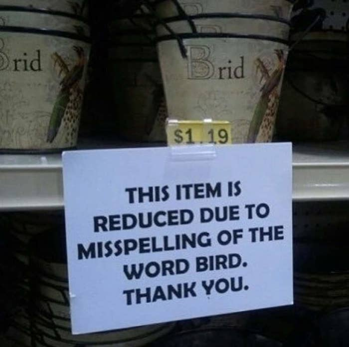 """A sign on a store shelf reads """"This item is reduced due to misspelling of the word bird thank you."""" It is next to a decorated bucket with letters that read """"brid"""""""