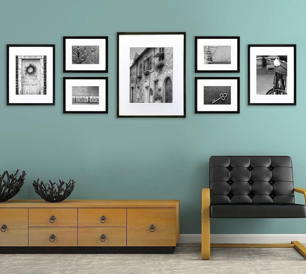 seven picture frames with black frames