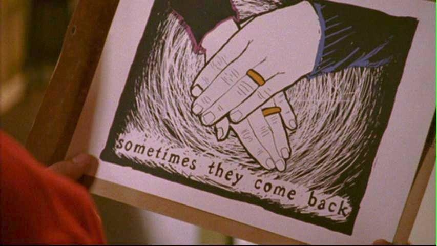 """a drawing of two hands with wedding rings on them with the words """"sometimes they come back"""" below"""