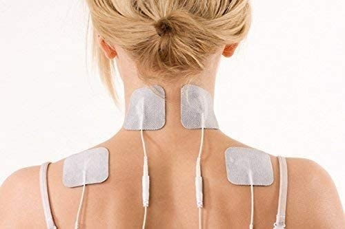 A person with four connected pads. There are two on the back of their neck and one on each shoulder.