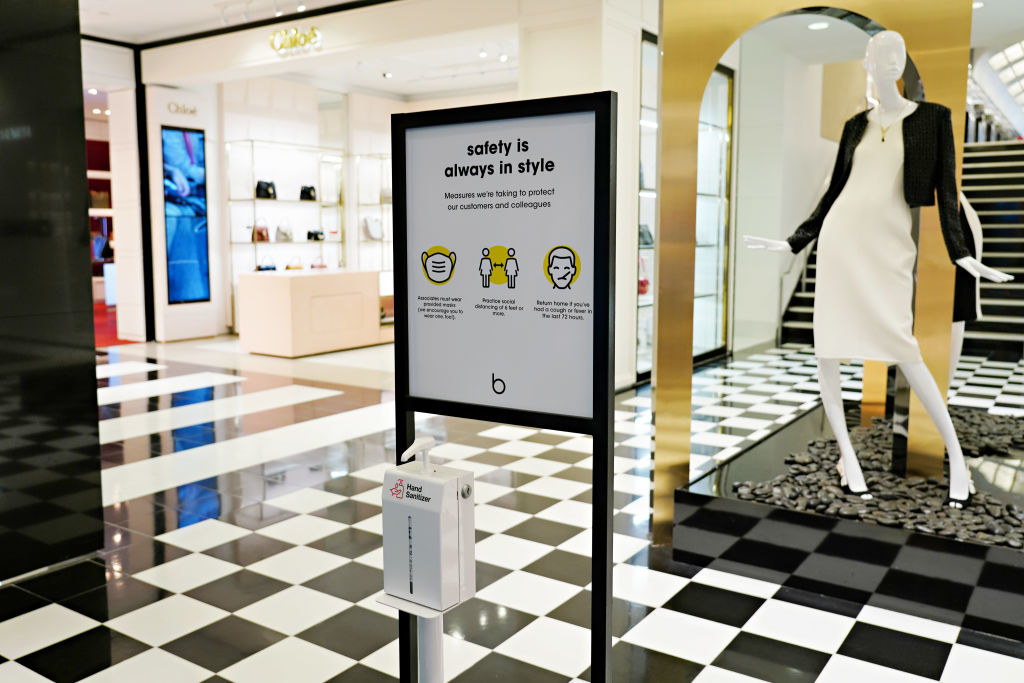 A sign describing safety measures is displayed inside Bloomingdale's