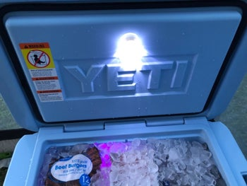 The light shining to illuminate the cooler's contents